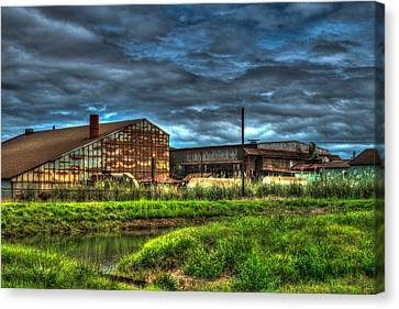 Industrial Complex With Angry Sky Canvas Print by Douglas Barnett