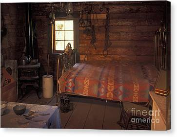 Interior Of A Loggers Cabin Canvas Print by Ron & Nancy Sanford