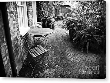 Into The Courtyard Canvas Print by John Rizzuto