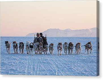 Inuit Hunters And Dog Sled Team Canvas Print by Cristina Mittermeier