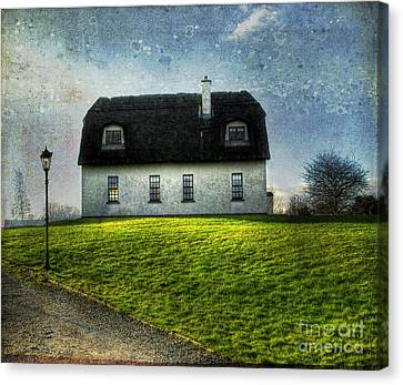 Irish Thatched Roofed Home Canvas Print by Juli Scalzi