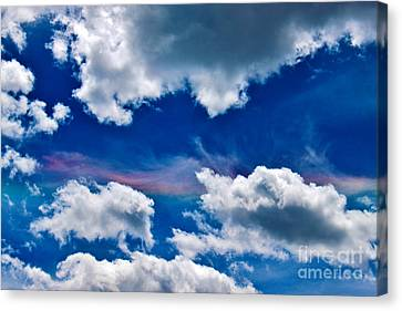 Irridescent Rainbows Among The Clouds Canvas Print by Janice Rae Pariza