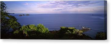 Island In An Ocean, Papagayo Peninsula Canvas Print by Panoramic Images