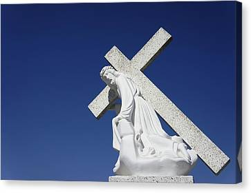 Jesus Carrying A Cross Canvas Print by Aged Pixel
