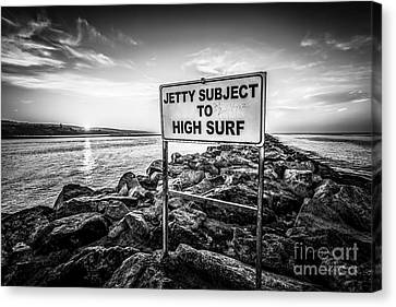 Jetty Subject To High Surf Sign Black And White Picture Canvas Print by Paul Velgos