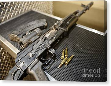 Joe Fox Fine Art - Ak47 Assault Rifle Magazine And Ammunition At A Gun Range Canvas Print by Joe Fox