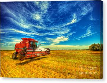 Kansas Combine Canvas Print by  Caleb McGinn