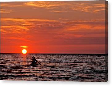 Kayaka At Sunset Canvas Print by Jim West