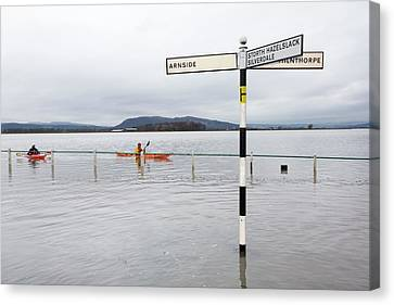 Kayakers In The Flood Waters Canvas Print by Ashley Cooper
