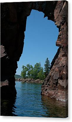 Kayaking Through The Arch Canvas Print by Sandra Updyke