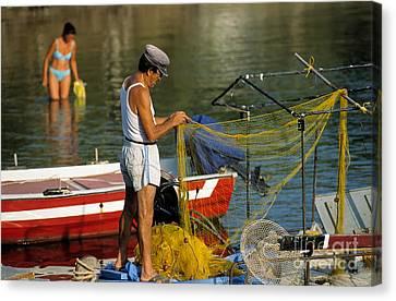 Fisherman In Kea Island Canvas Print by George Atsametakis