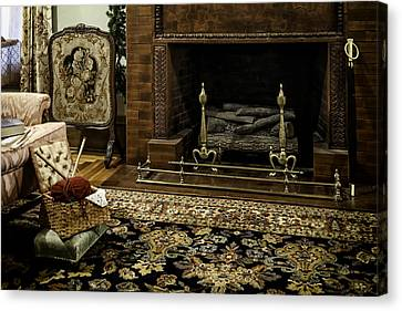Knitting In Front Of A Vintage Fireplace Canvas Print by Lynn Palmer