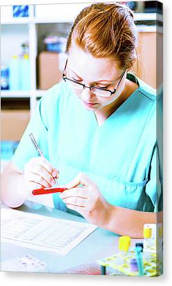 Lab Assistant Writing On Test Tube Label Canvas Print by Wladimir Bulgar