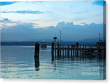Lake Garda Pier And The Last Ferry For The Day Canvas Print by Kiril Stanchev