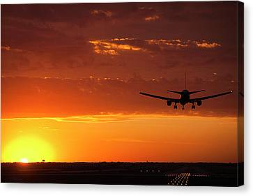 Landing Into The Sunset Canvas Print by Andrew Soundarajan