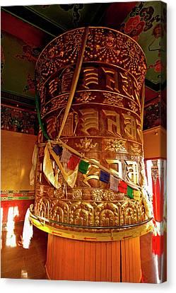 Large Prayer Wheel In A Buddhist Canvas Print by Jaina Mishra