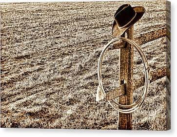 Lasso And Hat On Fence Post Canvas Print by Olivier Le Queinec