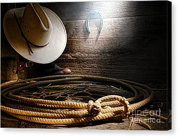 Lasso In Old Barn Canvas Print by Olivier Le Queinec
