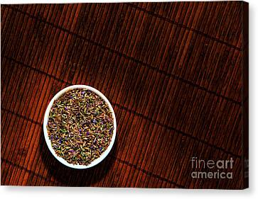 Lavender Flower Seeds In Dish Canvas Print by Olivier Le Queinec