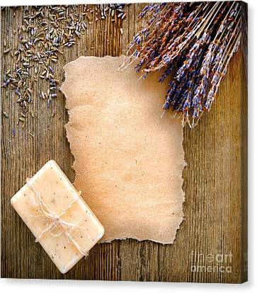 Lavender Flowers And Soap Canvas Print by Olivier Le Queinec