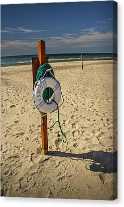 Life Preserver On The Beach In Pentwater Michigan Canvas Print by Randall Nyhof