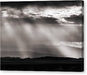 Light Rays And Rain Canvas Print by Leland D Howard
