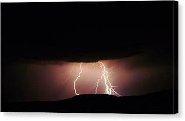 Lightning Dancing Canvas Print by Jeff Swan
