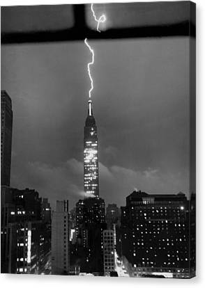 Lightning Hits Empire State Canvas Print by Underwood Archives