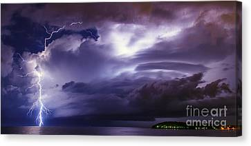 Lightning Over The Sea Canvas Print by Nino Rasic