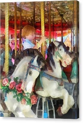 Little Boy On Carousel Canvas Print by Susan Savad