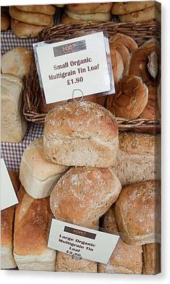 Loaves Of Organic Bread Canvas Print by Ashley Cooper