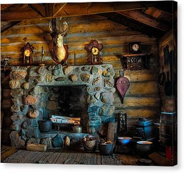 Log Cabin With Fireplace Canvas Print by Paul Freidlund