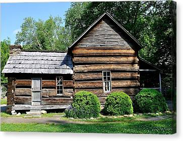 Log House Canvas Print by Todd Hostetter