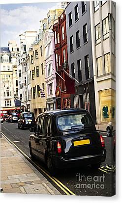 London Taxi On Shopping Street Canvas Print by Elena Elisseeva