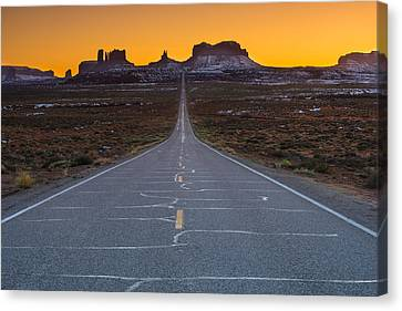 Long Road To Monument Valley Canvas Print by Larry Marshall