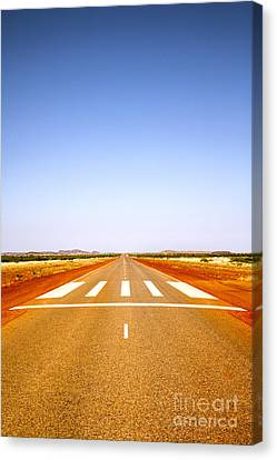 Long Straight Road Marked Out As Emergency Runway Canvas Print by Colin and Linda McKie