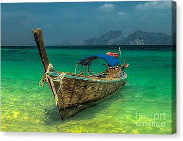 Longboat Canvas Print by Adrian Evans