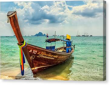 Longboat Asia Canvas Print by Adrian Evans