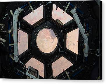 Looking Down - Astronaut Window Canvas Print by World Art Prints And Designs