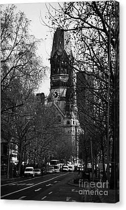 looking down Kurfurstendamm towards Kaiser Wilhelm Gedachtniskirche memorial church Berlin Germany Canvas Print by Joe Fox