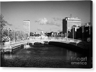 Looking Down The Liffey Towards The Hapenny Ha Penny Bridge Over The River Liffey In Dublin Canvas Print by Joe Fox