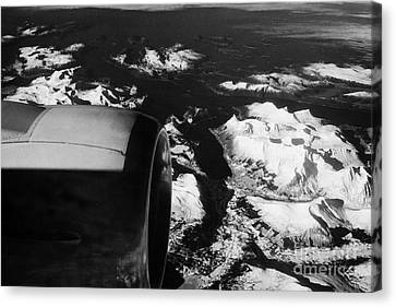 Looking Out Of Aircraft Window Past Engine And Over Snow Covered Fjords And Coastline Of Norway Euro Canvas Print by Joe Fox