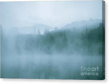 Lost In Fog Over Lake Canvas Print by Jola Martysz