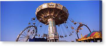Low Angle View Of A Ride At An Canvas Print by Panoramic Images