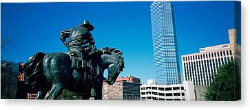 Low Angle View Of A Statue In Front Of Canvas Print by Panoramic Images