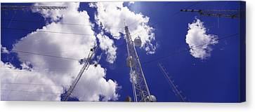 Low Angle View Of Radio Antennas Canvas Print by Panoramic Images
