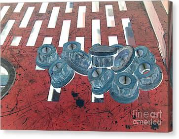 Lug Nuts On Grate Horizontal Canvas Print by Heather Kirk