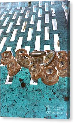 Lug Nuts On Grate Vertical Turquoise Copper Canvas Print by Heather Kirk