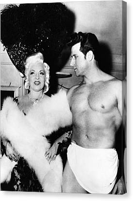 Mae West, Left, And One Of Her Muscle Canvas Print by Everett