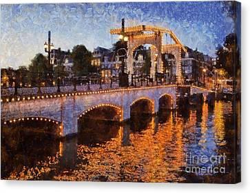 Magere Brug Bridge In Amsterdam Canvas Print by George Atsametakis